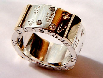 Sterling-Silver-Yellow-Gold-Diamond-Wedding-Band-with-Crosses-from-Dogstone-on-Etsy-Dogstone